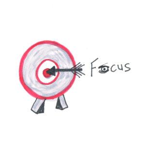 Focus dartbord met pijl in de roos