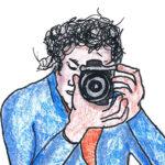 Man met camera maakt foto van focus